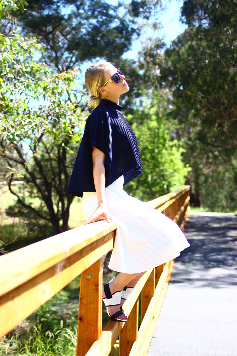 Styled by Sasha in Laden Showroom navy crop and Lulu and Rose Midi Skirt